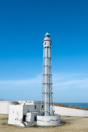 Trafalgars lighthouse at the province of Cadiz with clear blue sky in the background.