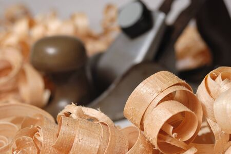 carving tool: Wooden chips and plane over blurry background