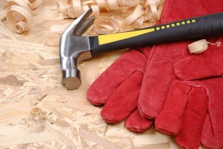 Hammer, gloves and wooden chips photo