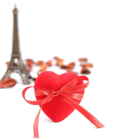 aside: Red heart with Eiffel tower aside over white  background