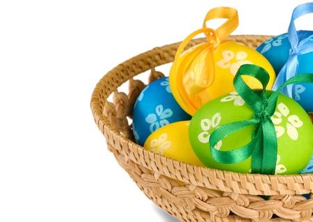 good friday: Easter eggs in wicker basket over white background Stock Photo