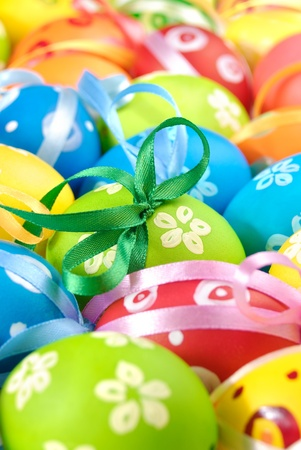 Painted easter eggs with bows uniform background photo