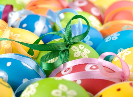 easter decorations: Painted easter eggs with bows uniform background Stock Photo