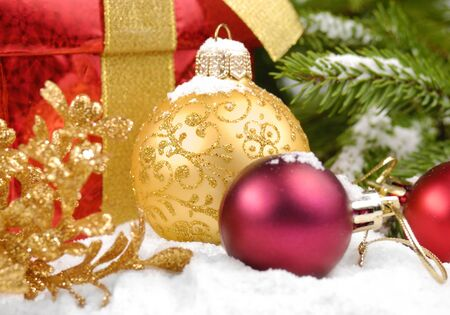 Christmas balls with gift box under christmas tree photo