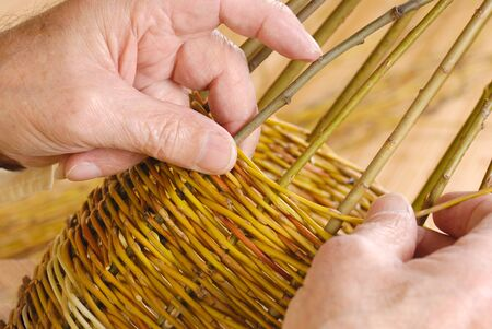 Old mans hands and wicker basket
