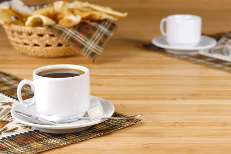 white napkin: Coffee cup with sugar and cookies on the wooden table