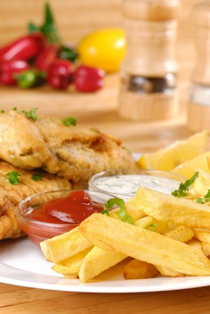 eating fish: White plate with fish and chips, mayo and ketchup Stock Photo