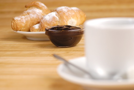 coffee jelly: Coffee cup and croissants with jelly on the wooden table Stock Photo