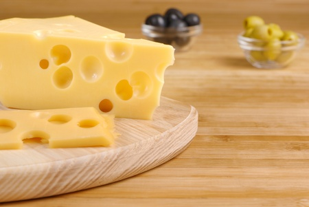 Emmental cheese on the cutting board photo