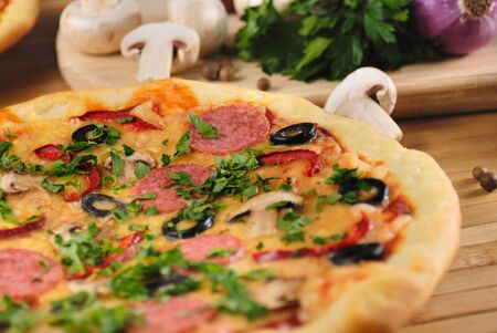 Pepperoni pizza with mushrooms and olives Stock Photo - 9007949