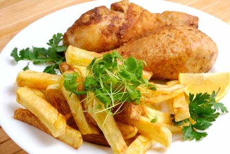 Fried chicken legs and potato photo