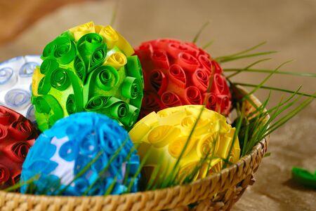 Easter eggs in wicker basket over golden background