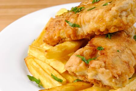 codfish: Fried fish and chips on the white plate Stock Photo