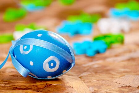 Easter eggs over wooden background