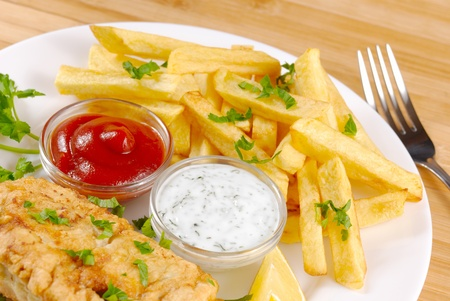 White plate with fish and chips, mayo, lemon and ketchup Stock Photo - 9221669
