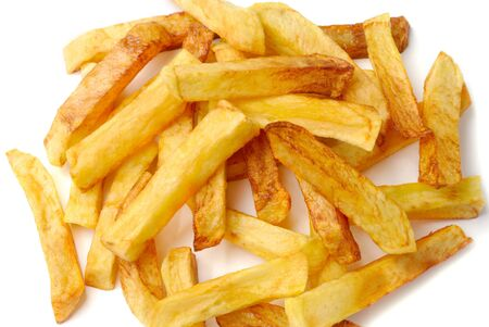 Fried potato chips isolated on white background photo