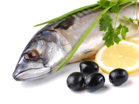 Fresh mackerel with olives and lemons over white background