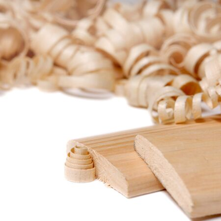 Sawdust and planks over white background Stock Photo - 9290649
