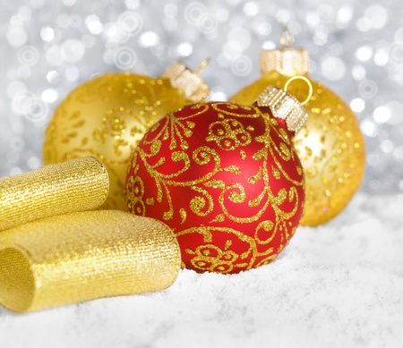 shallow: Red and golden christmas balls on the snow, shallow depth of field Stock Photo