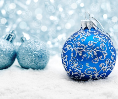 depth: Blue christmas balls on the snow over blurry background, shallow depth of field Stock Photo