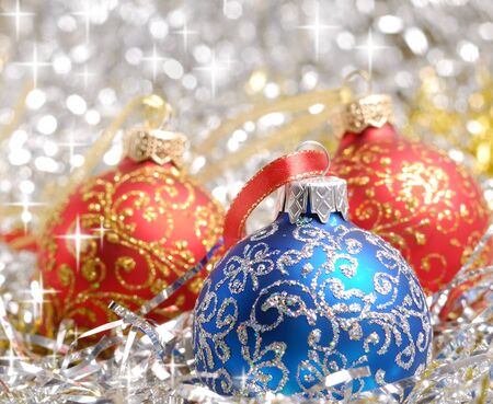 Red and blue christmas balls over blurry background. Shallow depth of field photo