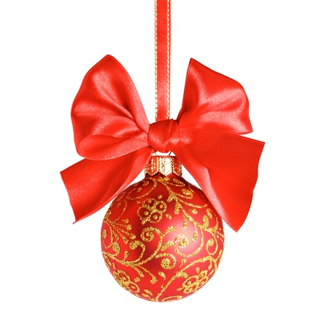 Red christmas ball and bow over white background, shallow depth of field, clipping path embedded
