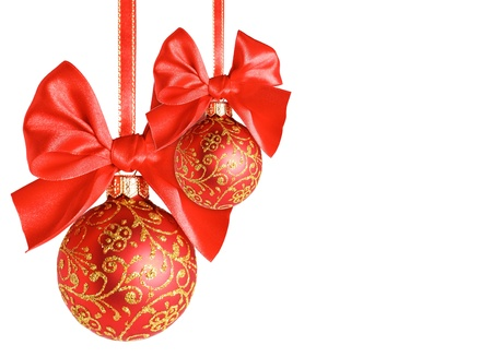 the depth: Red christmas balls with bows over white background, shallow depth of field Stock Photo