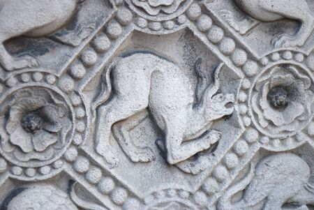 chimera: Chimera carved in stone wall of Notre Dame de Paris  Stock Photo