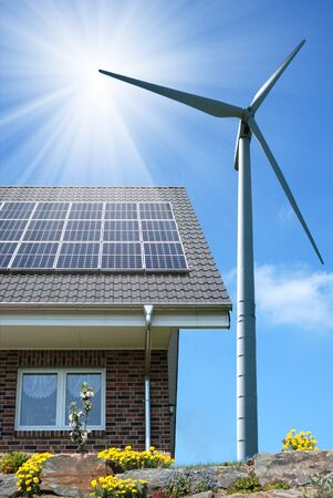generators: Roof with solar panels and wind turbines aside Stock Photo
