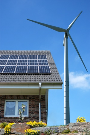 Roof with solar panels and wind turbines aside Stock Photo - 9291040