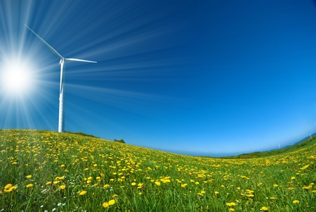 Wind turbine under blue sky