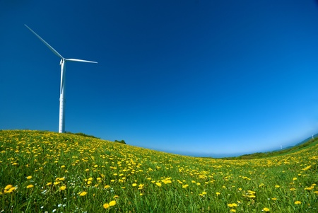 Wind turbine under blue sky photo