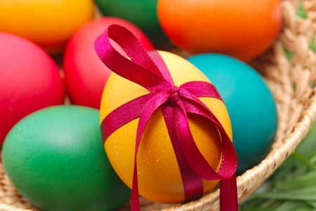 Easter eggs in wicker basket photo