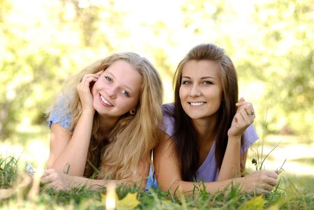 Two teenage girls having fun outdoors Stock Photo