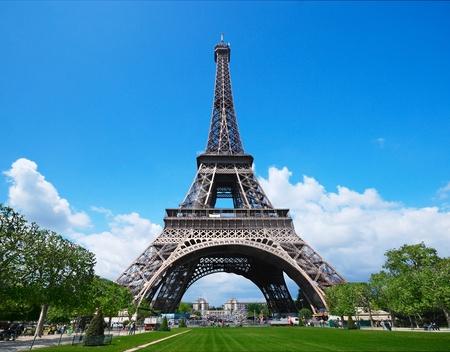 The Eiffel Tower against a blue sky