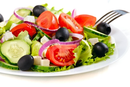 salad fork: Greek salad in the white plate closeup shot Stock Photo
