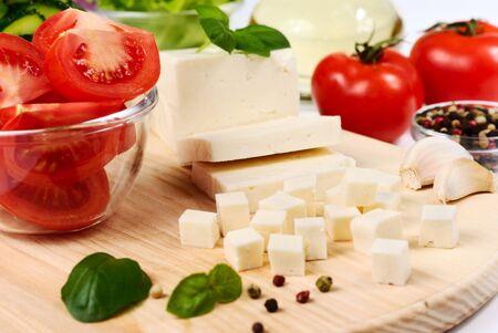 Fresh vegetables on the chopping board closeup photo