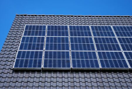 Roof with solar panels fragment under blue sky Stock Photo - 9449343
