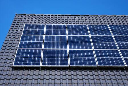 Roof with solar panels fragment under blue sky Reklamní fotografie - 9449343