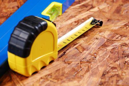 hardboard: Carpenter tools over hardboard