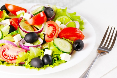Greek salad in the white plate closeup shot Stock Photo