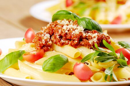Rigatoni pasta with a tomato beef sauce and Parmigiano-Reggiano Reklamní fotografie
