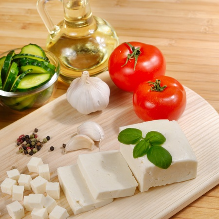 cheese board: Fresh vegetables on the chopping board closeup Stock Photo