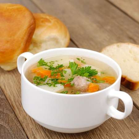 broth: Homemade soup with meatballs on the kitchen table