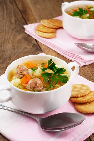 Homemade soup with meatballs on the wooden table Stock Photo - 9997242