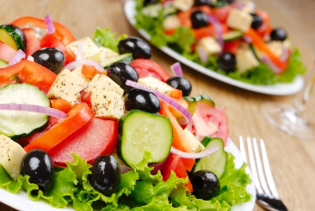 Greek salad in the white plate on the kitchen table Stock Photo - 10303746