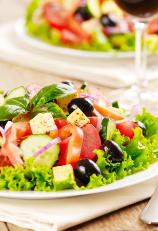 Greek salad on the oak table photo