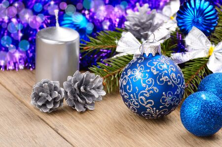 Christmas tree decorations with candle on the wooden table photo