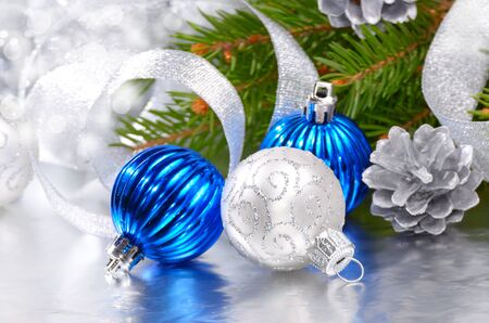 Blue and silver Christmas balls over bright background photo