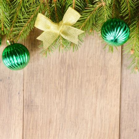 Christmas decoration border over wooden background photo